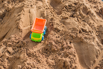 small toy truck working on sand quarry, construction concept, copy space