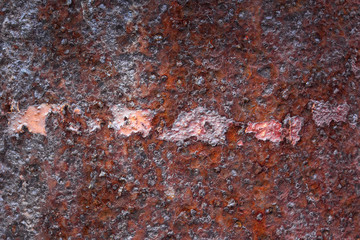 bright texture of rusty metal with small stains of paint industrial background