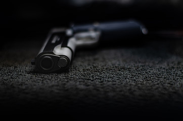 Black background gun with black and Monochrome tone..