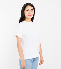 young korean,asian brunette woman in blank white t-shirt, t shirt design and people concept. Shirts front view isolated on white background, mock up, copy space.