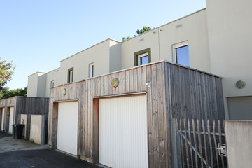 recent terraced house with garage in the suburbs
