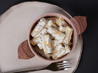 Rigatoni with cream, gorgonzola, and olives, a vegetarian plate known in Itlay as pasta alla cenere, literally meaning pasta with ash