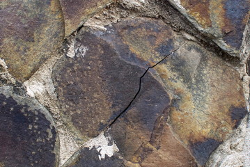 Close up of stone wall texture, with vibrant colors for creativity, imaginative backgrounds and ideas. Suitable for print, web, postcards, posters, flyers.