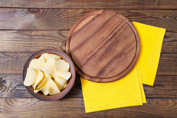 potato chips,wooden desk and yellow napkins on table, food concept,mock up