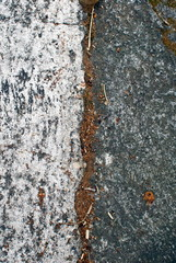 Close up of wall and pavement texture for creativity, imaginative backgrounds and ideas. Suitable for print, web, postcards, posters, flyers.