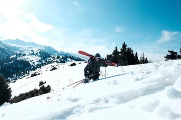 Freeride skis uphill backlit rising sun