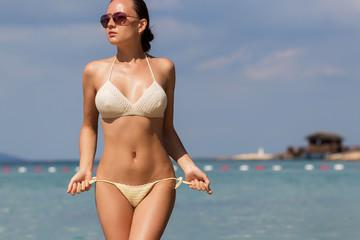Woman untying swimwear panties