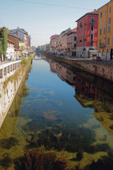 Transparent water in channel Naviglio Grande. Milan, Italy