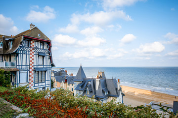 Tuinposter Europese Plekken Top view of Trouville city with luxury houses and beautiful beach on the background during the morning light in France