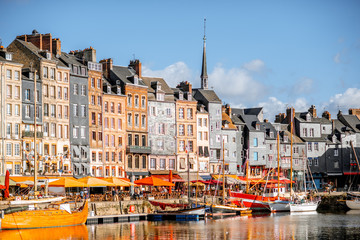 Waterfront with beautiful old buildings in Honfleur, famous french town in Normandy Fototapete
