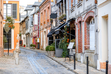 Street view with beautiful old buildings in Honfleur, famous french town in Normandy Fototapete