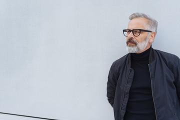 Handsome older bearded man standing waiting