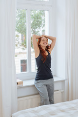 Happy relaxed young woman stretching