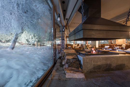 Big window in winter night and restaurant interior