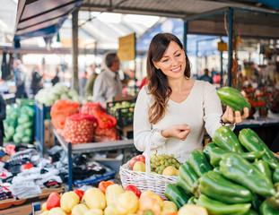 Young woman at local food market.