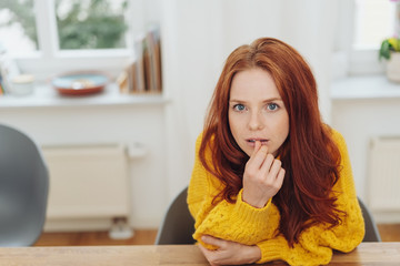 Thoughtful intense young redhead woman