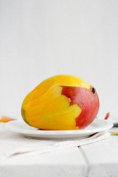 Peeled mango on plate