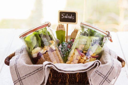 Two salads in jars into a bascket prepared in a buffet service for a brunch