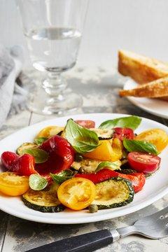 Vegetable antipasti salad with basil on plate