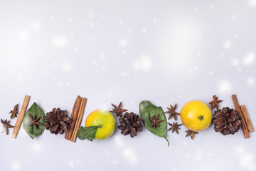 Food and Drink Seasonal and Holidays Concept Christmas Decoration with Oranges Cones Spices on a Light Blue Background Copy Space Christmas NewYear Card Concept Flat Lay Snow
