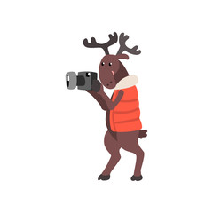 Deer in warm vest taking pictures with a camera, funny animal cartoon character traveling on vacation vector Illustration on a white background