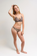 Studio portrait of a beautiful girl in his underwear swimsuit on a white background.