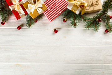Christmas mood concept. Layout composition with traditional festive attributes, green decorative fresh pine tree branches. Winter holidays season. Background, copy space, close up, top view, flat lay.