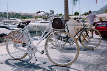 Vintage bicycles by the sea at the pier in monaco monte carlo on the background of yachts and blue sky