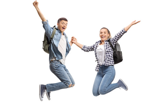Happy male and female students jumping