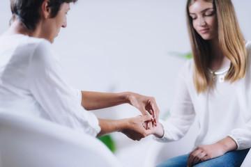 Teenage Girl Having Theta Healing Treatment