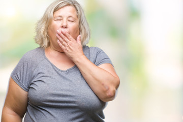 Senior plus size caucasian woman over isolated background bored yawning tired covering mouth with hand. Restless and sleepiness.