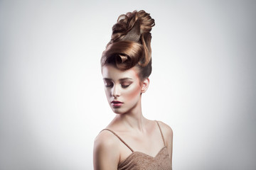 Papiers peints Salon de coiffure portrait of attractive brunette woman with stylish hairdo and makeup posing with closed eyes on isolated grey background. indoor, studio shot on copy space.