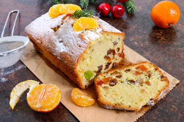 Christmas cake with nuts, dried fruit, tangerines. Traditional festive pastries.