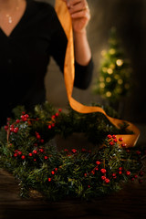 Woman decorating holiday wreath