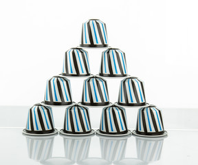 Coffee capsules on white background
