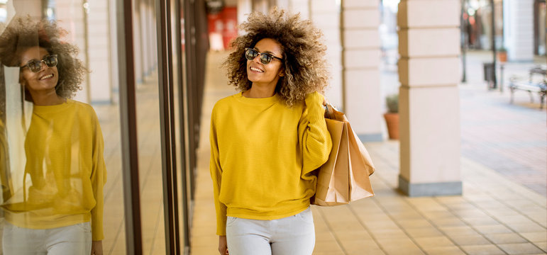 Young black woman with curly hair in shopping