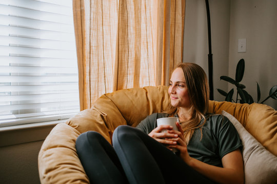 Woman relaxing at home with mug