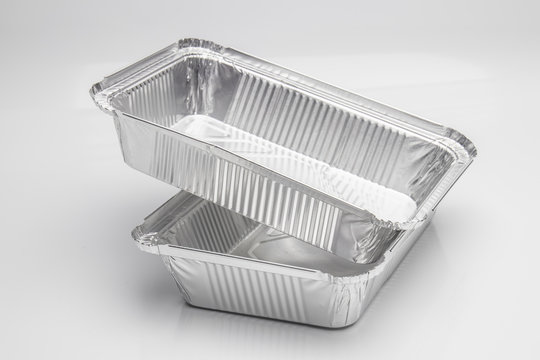 Foil food delivery container with reflection isolated over the white background
