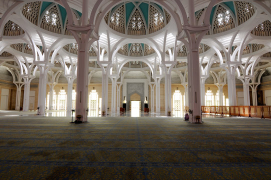 The interior of Sarawak State Mosque. The mosque has one big main prayer hall covered with one big and beautiful dome and supported with other small domes.