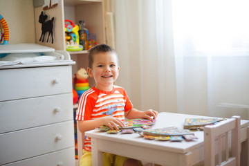 A boy in kindergarten loves to read different stories