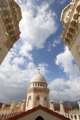Church tower and dome together with sky and clouds
