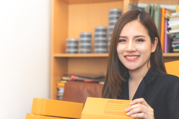 Beautiful woman is managing her product delivery for her online business