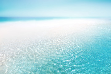 tropical beach with white sand and blurred ocean backgrounds