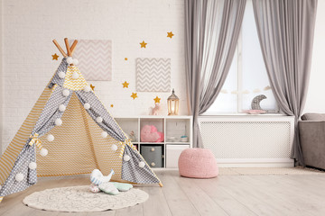Cozy kids room interior with play tent and toys