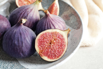 Plate with fresh ripe figs on table, closeup