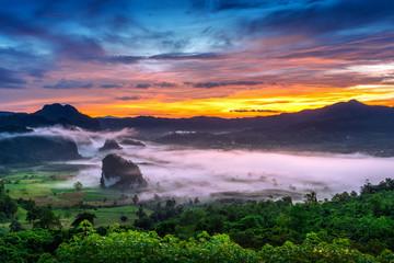 Wall Mural - Sunrise on the morning mist at Phu Lang Ka, Phayao in Thailand.