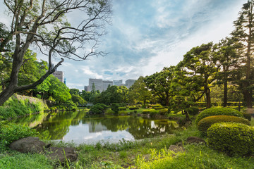 Shinji Pond in the public garden of Hibiya Park bordering the southern moat of the Imperial Palace. The word Shinji is composed of 2 ideograms which are the heart and the form.