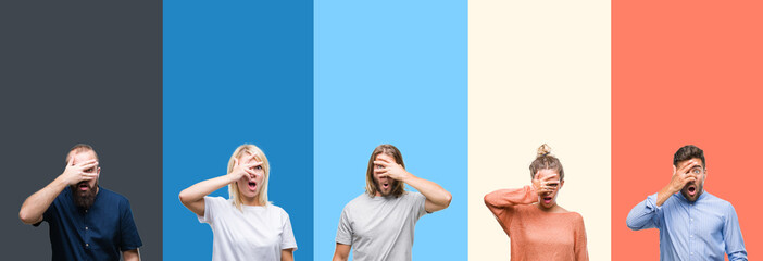 Collage of casual young people over colorful stripes isolated background peeking in shock covering face and eyes with hand, looking through fingers with embarrassed expression.
