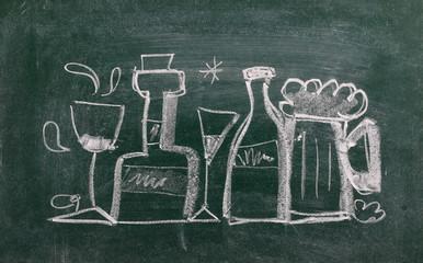 Bottle and glasses symbol, sign on chalkboard, blackboard texture