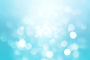 Abstract colorful blur blue texture background with white and blue bokeh circles in soft color style. Template for underwater backdrop or winter design illustration.